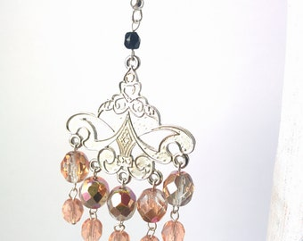 Long dangle chandelier earrings with creamy colort glass beads and metal details