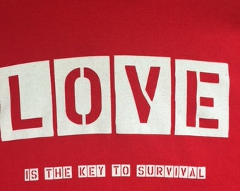 Love is the key to survival - Youth Hoodie