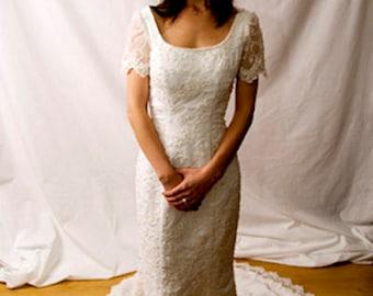 Never worn beautifully hand beaded mermaid wedding dress by Nu Mode Canada