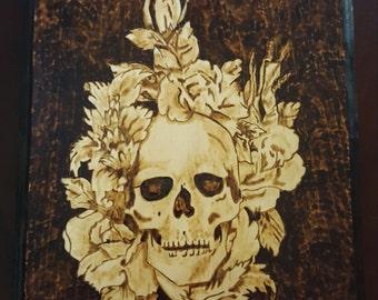 Skull and flowers woodburning