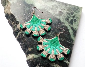 Embroidered by hand, flowers, Silver earrings and shades of green.
