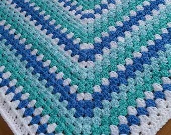 Handmade Crochet blanket. Made in acrylic yarn, machine washable and tumble dry on low heat.