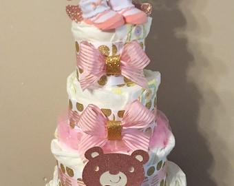 Pink and Gold Diaper Cake with a hidden bonus hidden inside diaper cake