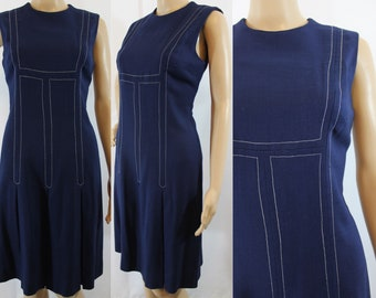 60s vintage navy blue dress with white stitch details, drop waist and pleated skirt size medium