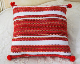 Folk pillow decor on two sides.