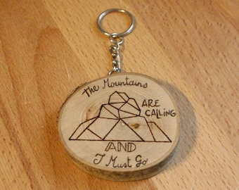 "Wooden keychain with ""the mountains are calling and i must go"" lettering and mountain design (personalized on request) - gift idea"