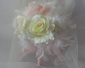 round bridal bouquet feathers and roses