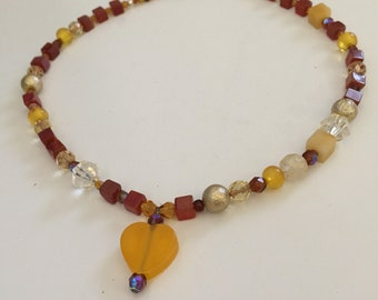 Orange heart pendant with red yellow golden gems and beads necklace jewelry