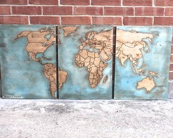 Crafty hands full heart by craftyhandsfullheart on etsy distressed blue wood world map with woodburned outlines of countries and pins to track travel gumiabroncs Images