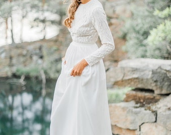 Modest wedding dress with long sleeve lace bodice
