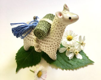 LUPIN - Hand sculpted porcelain Travel Llama totem with handmade backpack roll, tassel and bell