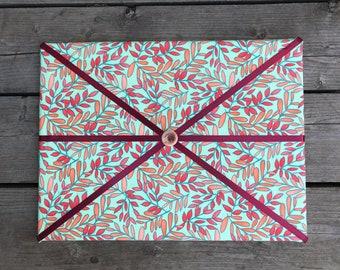 Green Floral Fabric Board w/ Burgundy Ribbon (SC)