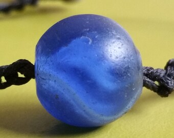 Antique German cobalt blue glass marble African Trade bead with white swirl inner