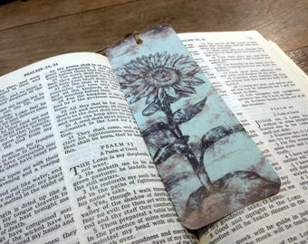 Bookmark Sunflower. Vintage appearance. Light blue.
