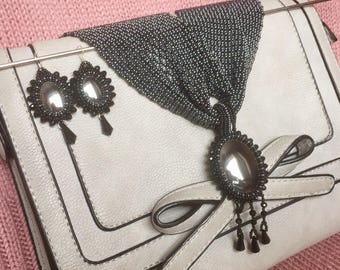 Beaded jewelry set with hematite cabochones and sparkling crystals