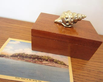 Free shipping.  Wood box with brass shell.  Classic decor.