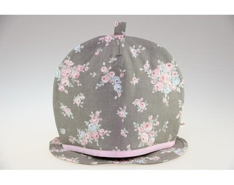 Covers gray cotton with bouquets of roses and its insulating carpet teapot.
