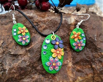 Set oval green with small flowers made with polymer clay.