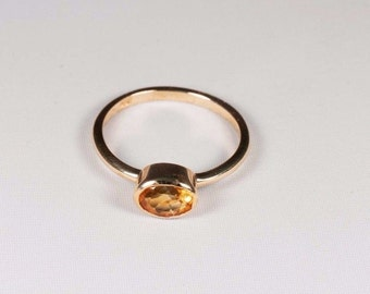 1.9 Gram. 14K Yellow Gold Orange Sapphire Ring, size 6.5