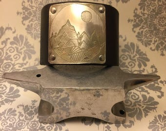 Adjustable leather and etched metal mountain cuff