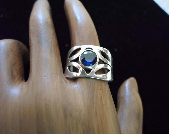 Wide band bithstone ring w/6mm created faceted stone