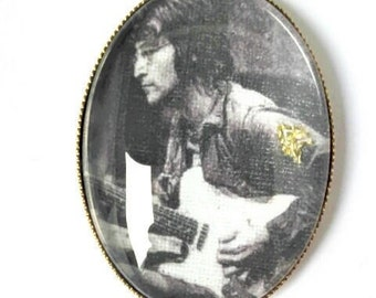 The pendant is embroidered by hand of John Lennon
