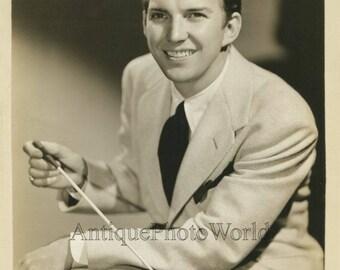 Smiling musician Bob Allen jazz orchestra leader w baton antique photo