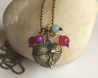 Antique brass heart shaped locket