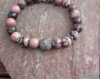 Bracelet with Rhodonite 8 mm with a Pearl of Bali silver 10mm, sterling silver spacer beads and pretty Pearl in Ohm silver