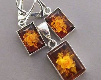 Carved genuine Baltic amber sterling silver  earrings and pendant.