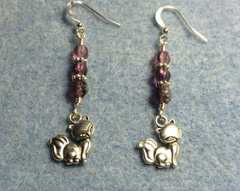 Small silver cat charm dangle earrings adorned with purple Czech glass beads.
