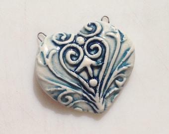 Designer porcelain ceramic heart pendant handmade.