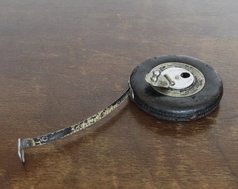 Very Old Leather Covered Metal Tape Measure
