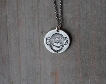 Monkey face fine silver pendant