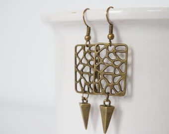 Bronze cutout earrings.