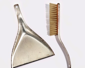 A set of small dustpan and broom