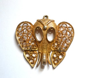 Vintage Gold Tone Filigree Articulated Elephant Head Pendant by Rafaerian