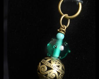 long turquoise glass bead black leather and antique brass pendant