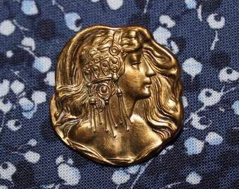 "Art Nouveau brass repousse pin of elegant female head in Egyptian style headress 1"" x 1"""