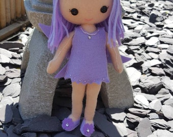 Cute felt fairy with removeable wings and clothes.