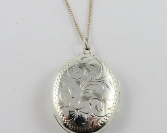 Sterling Silver Oval Locket With Floral Motif  With An 18 Inch Chain