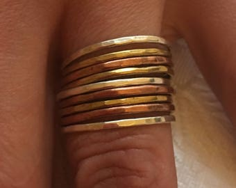 Size 60 - Mult rings 9, 925 sterling silver, copper ring, brass.