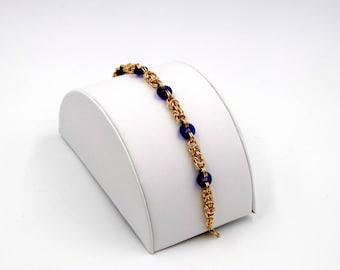 14k Gold Fill Byzantine Bracelet with sapphire blue glass rings