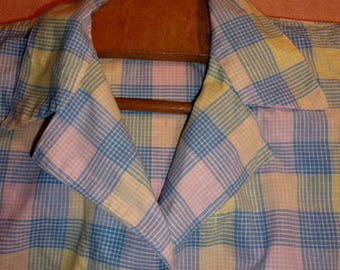 A rustic old blouse that children wore to school