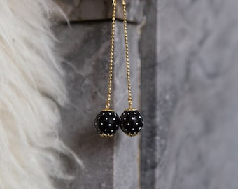 Background white polka dot earrings black