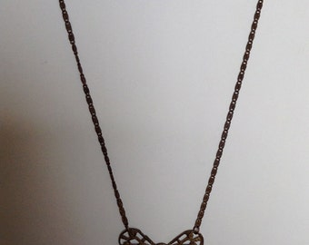 1920's brass bow necklace.