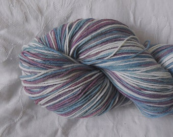 Aqua/mauve/white self-striping sock yarn