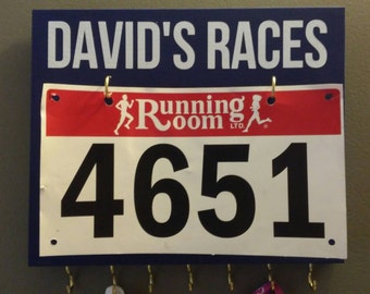 Painted wooden medal holder/hanger/display customized with vinyl quote and 7 metal hooks and race bib display