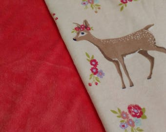 Coral colored woodland themed blanket