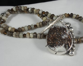 Astrophyllite Cabochon in a handmade sterling setting on a jasper beaded necklace